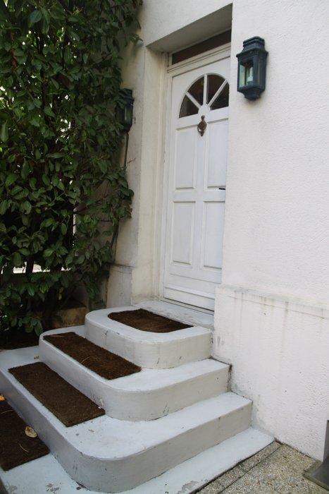 Photo décoration entrée de maison avec escalier